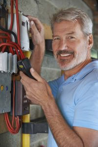 Portrait Of Man Taking Electricity Meter Reading